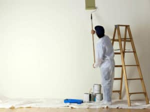 painting contractor painting with a roller